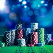 Casino Poker Chips on a gaming table with dramatic...