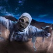 Scary Halloween mummy in desert with dramatic ligh...