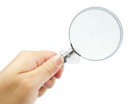 Photo pour Main tenant loupe sur fond blanc - image libre de droit