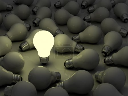 Photo for One glowing light bulb standing out from the unlit incandescent bulbs, idea business concept , stand out from the crowd concept - Royalty Free Image