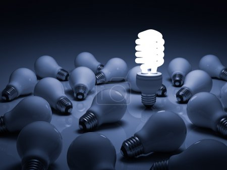 Photo for Business concept, stand out from the crowd concept, Eco energy saving light bulb , one glowing compact fluorescent lightbulb standing amongst the unlit incandescent bulbs with reflection - Royalty Free Image