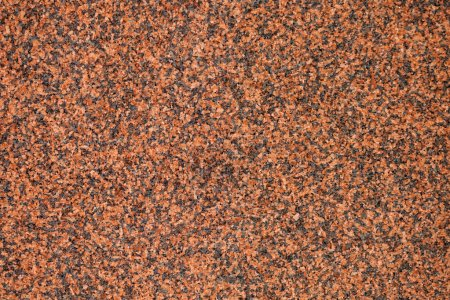 Granular texture of a Slab of Red Polished Granite