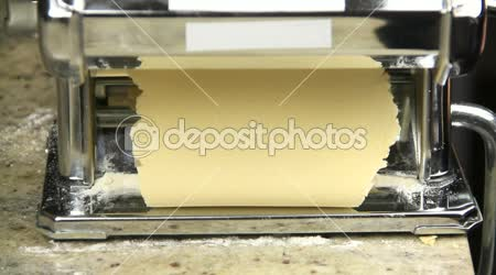 Dough sheets coming out of pasta machine
