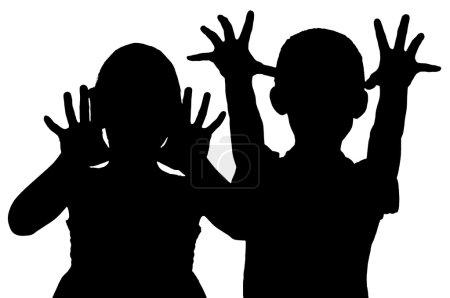 Foto de Silueta asustando a los niños que levantaron la mano - Imagen libre de derechos