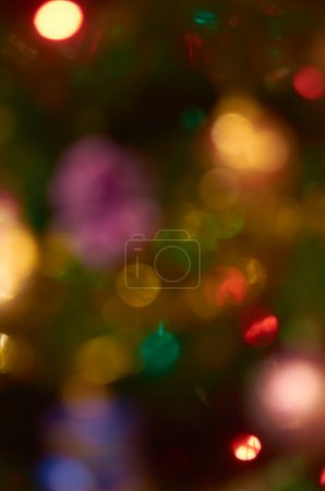 Background.Natural red blur abstract christmas background with selective focus