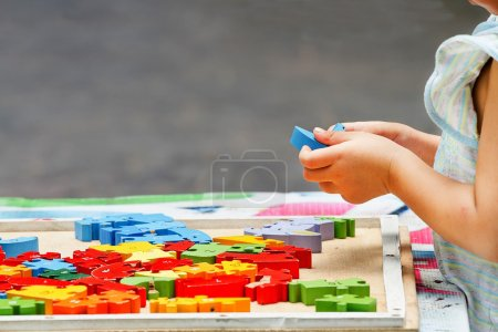 Photo for Hand child playing with construction blocks - Royalty Free Image
