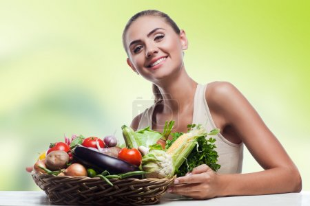 Photo for Happy young woman holding basket with vegetable. Concept vegetarian dieting - healthy food - Royalty Free Image