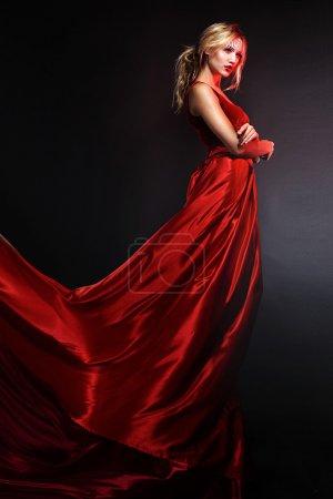 Woman in elegant red dress