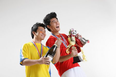 Asian sportsmen with trophies and medals