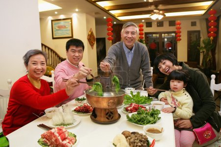A shot of Chinese family at dinner table