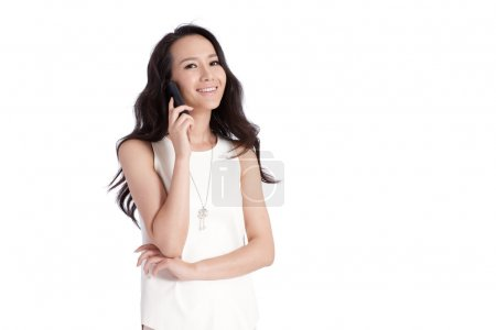 A shot of businesswoman calling by mobilephone