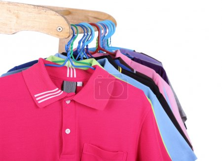 Photo for Hanging Polo shirt isolted on white background - Royalty Free Image