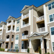 Newly finished apartment building in suburban area...