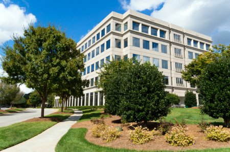 Photo for Suburban office building in a generic parkway setting - Royalty Free Image