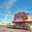 Ferris wheel and candy stand on a midway at a fair...