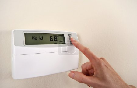 Adjusting and setting thermostat