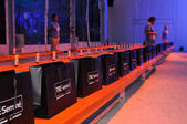 MIAMI - JULY 22: Designer gift bags at the White Sands Swimwear Presentation for Spring Summer 2013 during Mercedes-Benz Swim Fashion Week on July 22, 2012 in Miami, FL
