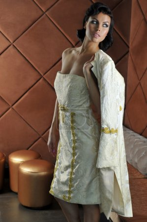 Model wearing couture designer gown in restaurant