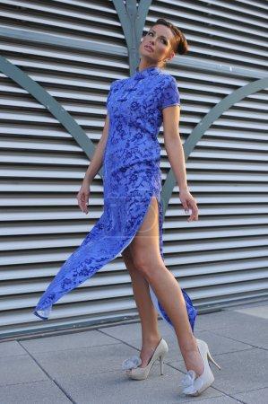 Model wearing blue couture designer dress
