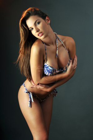 Pretty latin swimsuit fashion model posing sexy