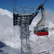 Spectacular view to the mountains and red ski tram...