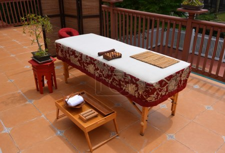 Oriental style massage table outside on the balcony