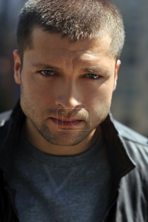 Male actor head shot showing action movie character