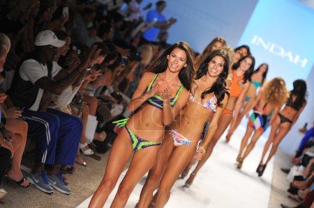 Models walks runway at the Indah Swimwear Collection
