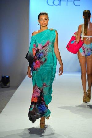A model walks the runway at the Caffe Swimwear show