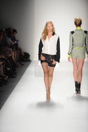 A model walks the runway at the Marissa Webb Spring 2014 fashion show