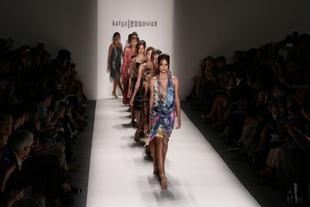 Models walk the runway at the Katya Leonovich fashion show