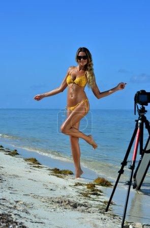 Sexy bikini model at tropical beach