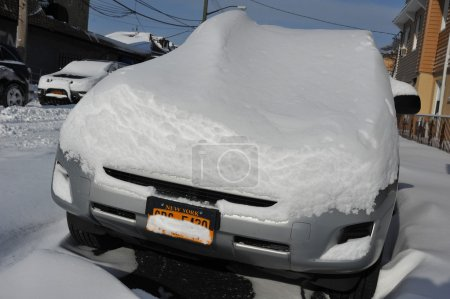 Car under deep fresh snow in NYC