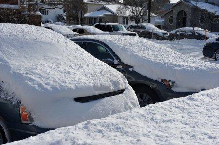 Car under deep fresh snow in NYC
