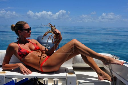 Sexy models holding lobsters