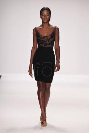 Model walks runway wearing Jamal