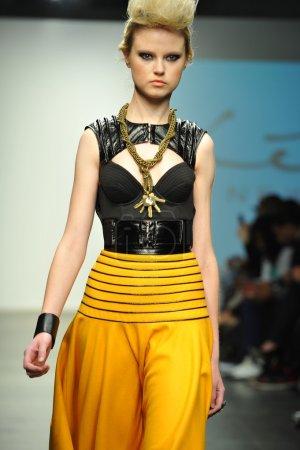 Model walks runway during Leka show
