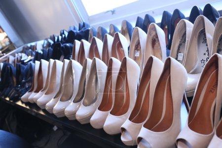 Model shoes backstage at Leka show
