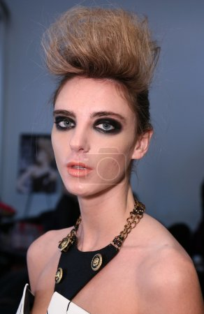 Model getting ready backstage at Leka show