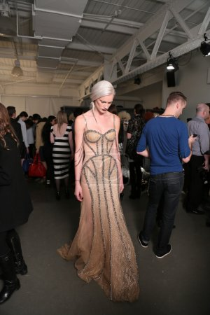 Model poses backstage at Dany Tabet show