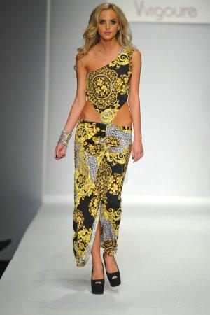 Los Angeles, CA - MARCH 13: A model walks the runw...