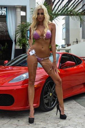 Leggy model and sports car