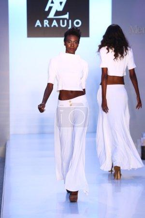 Model walks runway at AZ Araujo Swimwear collection