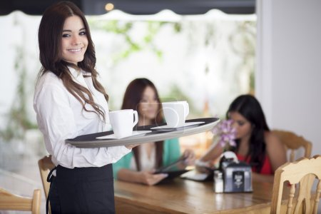 Photo for Portrait of young waitress holding a tray - Royalty Free Image
