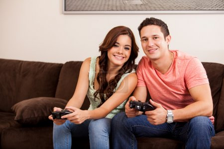 Couple playing video games together
