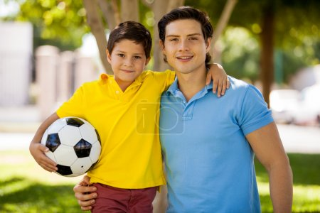 Father and his son holding ball