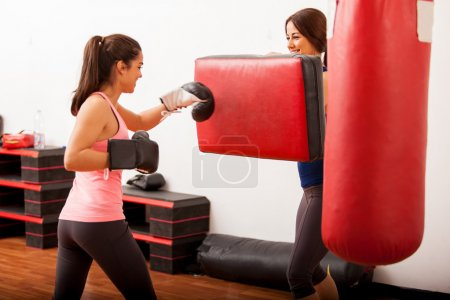 Girls engaged in boxing