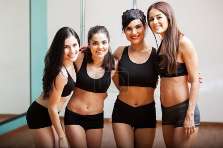 Photo for Happy young women during their pole fitness class - Royalty Free Image