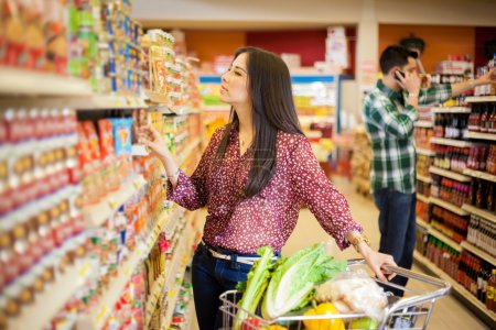 young woman  looking at the food label