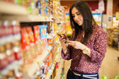 young woman  looking and reading  the food label